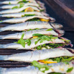 Stuffed fish grilling on BBQ — Stock Photo #71344125
