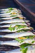 Stuffed fish grilling on BBQ — Stock Photo