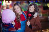 Teens at fair with candy — Stock Photo