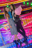 Girls at the fair with candy floss — Stock Photo