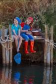 Summer kids fishing in creek lake pond or river — Stock Photo