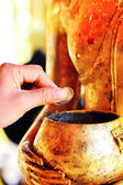 Buddha and gold bowl — Stock Photo