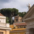 Colonnade and buildings in the Vatican. Rome, Italy — Stock Photo #53088441
