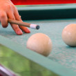 Hand with cue before the a blow to the billiard ball — Stock Photo #56216945