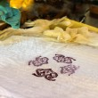 Artist prints stamped pattern on fabric — Stock Photo #56217105