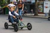 Kid in the play area riding a toy car. Nikolaev, Ukraine — Stockfoto