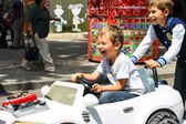 Kids in the play area riding a toy car. Nikolaev, Ukraine — Stock Photo