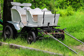Wagon in the yard of the rural house in Ukraine — Stock Photo