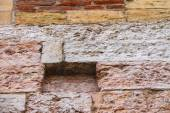 Fragment of a wall from stone and brick — Stock Photo