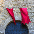 Red flags over the gates fortresses in San Marino. The Republic — Stockfoto #60039405