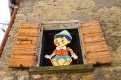 Pinocchio in the window  building store of wooden toys in San M — Stock Photo