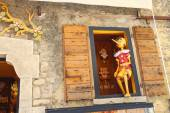 Pinocchio in the window  building store of wooden toys in San Ma — Stock Photo