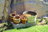 Wooden buckets and tubs in the courtyard of fortresses Guaita on — Stock Photo