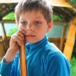 Pensive boy in the summer of wooden gazebo — Stock Photo #62042815