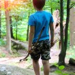 Boy with bow and arrow on a walk in the park. — Stock Photo #63858233