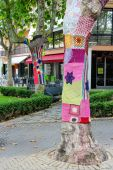 Knitted clothes on trees decorate street in the resort town Bell — Stock Photo
