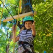 Brave little boy having fun at adventure park and giving  thumbs — Stock Photo #79199586