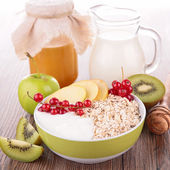Cereal with fruit and milk — Stock Photo