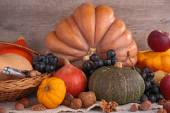 Pumpkins apples and nuts — Stock Photo
