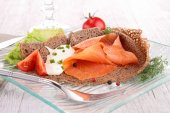 Crepe with salmon and cheese — Stock Photo