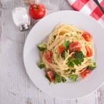 Spaghetti with broccoli and tomato — Stock Photo #56069979