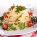Spaghetti with broccoli and tomato — Stock Photo #56070009