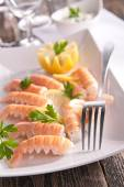 Tasty langoustine with lemon — Stock Photo