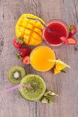 Fruit juice on wooden table — Zdjęcie stockowe