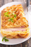 Puff pastry with cheese and bacon — Stock Photo