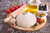 Pizza ingredients on wooden table — ストック写真