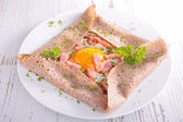 Crepe with egg and bacon — Stock Photo