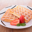 Waffles and strawberry on plate — Stock Photo #62450331