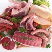 Composition with raw meats — Stock Photo