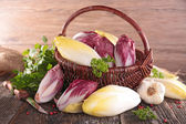 Basket with raw chicory — Stock Photo