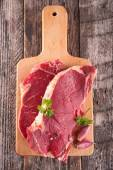 Raw meat on board — Stock Photo