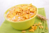 Cornflakes in bowl with milk — Stock Photo