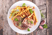 Grilled steak and french fries — Stock Photo