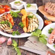 Grilled meat, sausages and vegetables — Stock Photo #70396371
