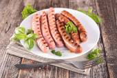 Grilled sausages in white plate — Stock Photo