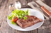 Grilled beef in white plate — Stock Photo