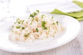 Rice with parsley on plate — Stock Photo