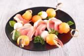 Buffet food with melon and mozzarella — ストック写真