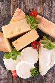 Cheese with cherry tomatoes and herbs — Stock Photo