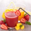 Mango and strawberry juice in glasses — Stock Photo #74459361
