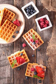 Waffles with berries on table — Stock Photo