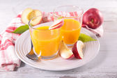 Peach juice in glasses — Stock Photo
