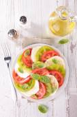 Tomato salad, caprese with basil — Stock Photo