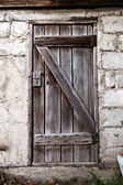 Old decayed wooden door — Stock Photo