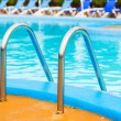Swimming pool with stair at hotel close up — Stock Photo #64469267