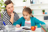 Mother Helping Daughter With Homework. — Stock fotografie
